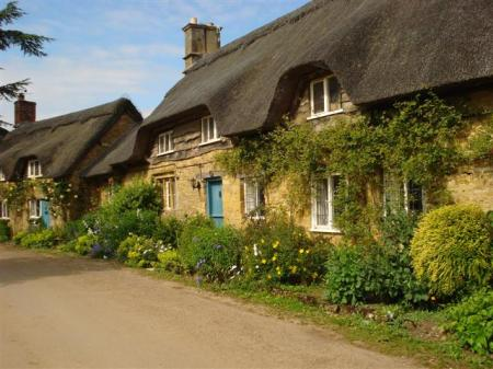 ... to this, maybe (thatched cottages at Hidcote)