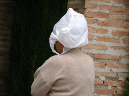 Coping with unexpected rain - a French visitor improvises at the Alhambra