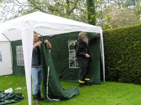 The kind neighbours, erecting a temporary gazebo (with the doubly kind neighbour to the left who happens to own said item)