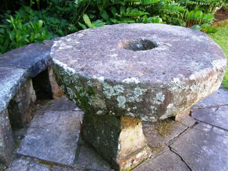 The antique stone mill wheels are fine as garden decoration