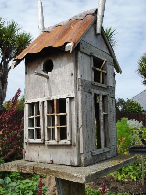 A quaint bird house built by a volunteer at the New Brighton Community Gardens