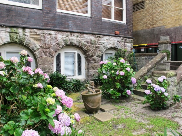 The gothic revival courtyard had a sense of romantic abandon at odds with its Coogee Beach location.