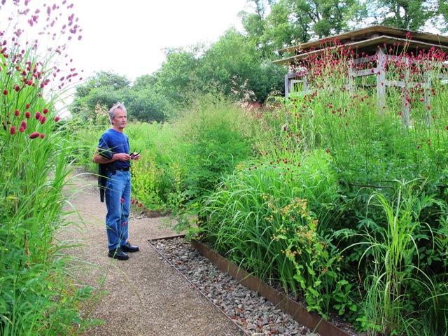 Mark, standing in the elegant grass garden at Bury Court