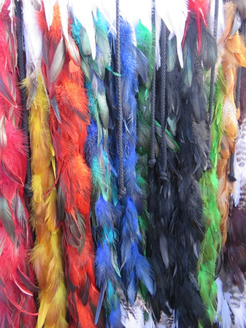 Colourful korowai - traditional Maori cloaks - made with dyed feathers
